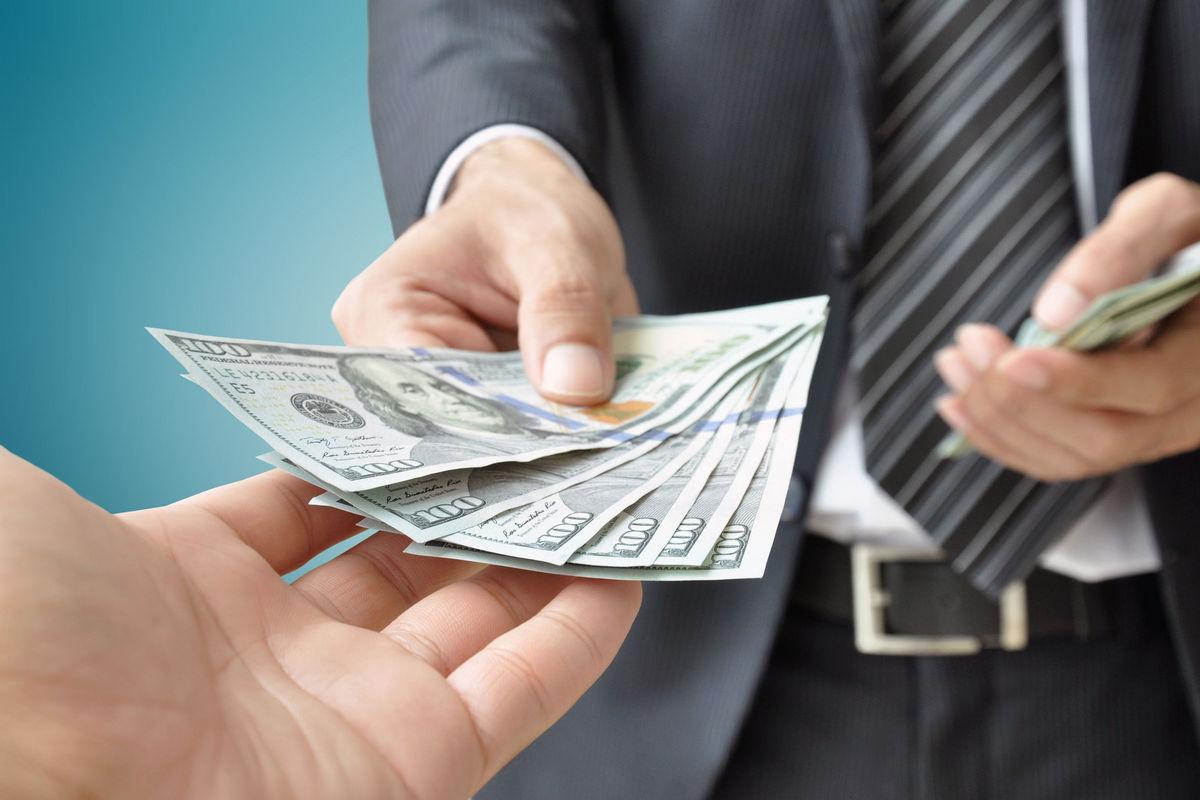 30445795 - hand receiving money from businessman - united states dollar (usd) bills